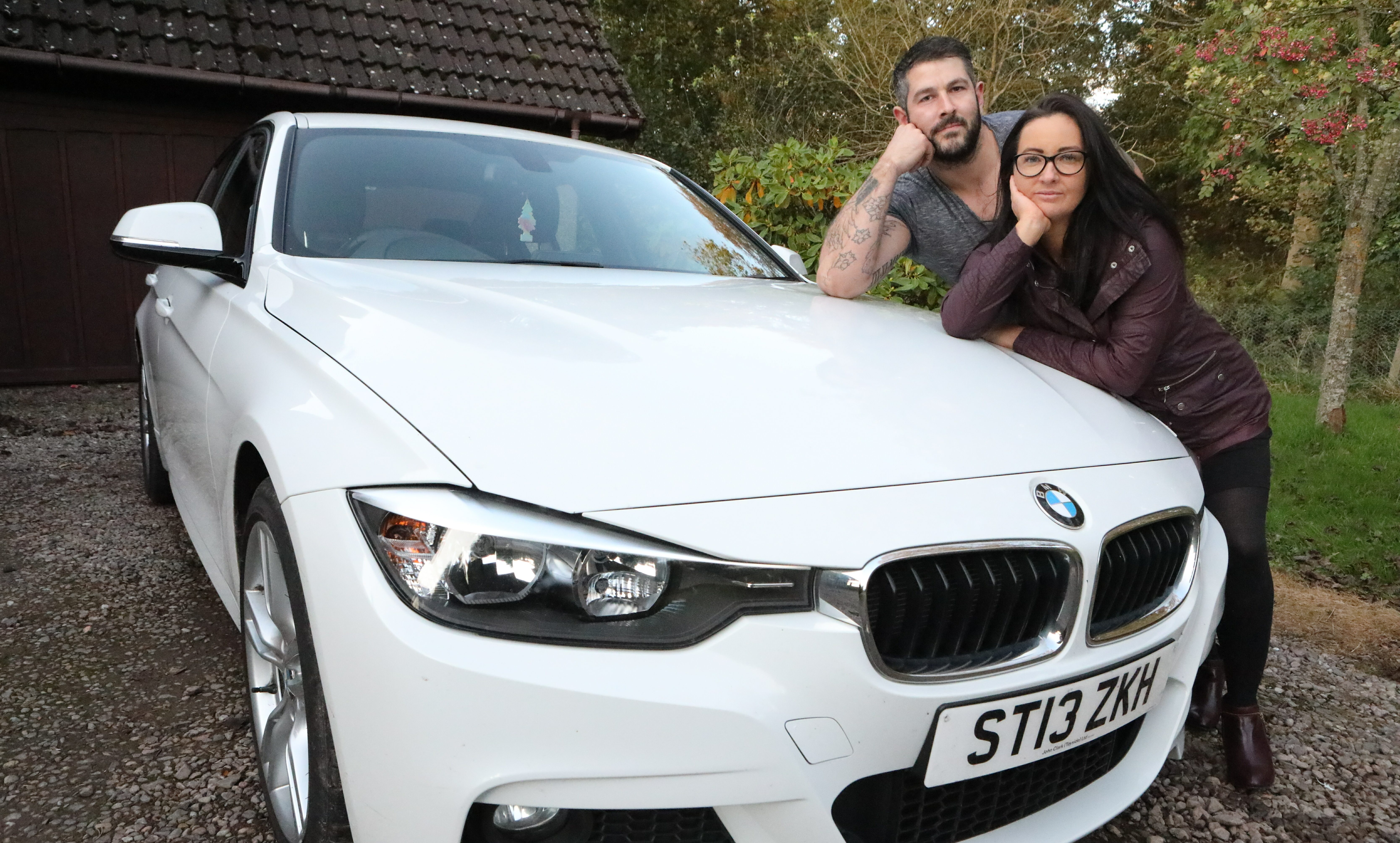 Ewan Fraser and his partner Sharon Shand with their BMW.