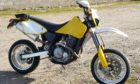 The yellow CCM604 motorbike, reg ST54TZZ,