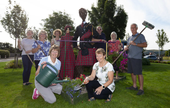 The Brig of Bloom committee show off Tartan figures Flora and Hamish ahead of judging in the summer.