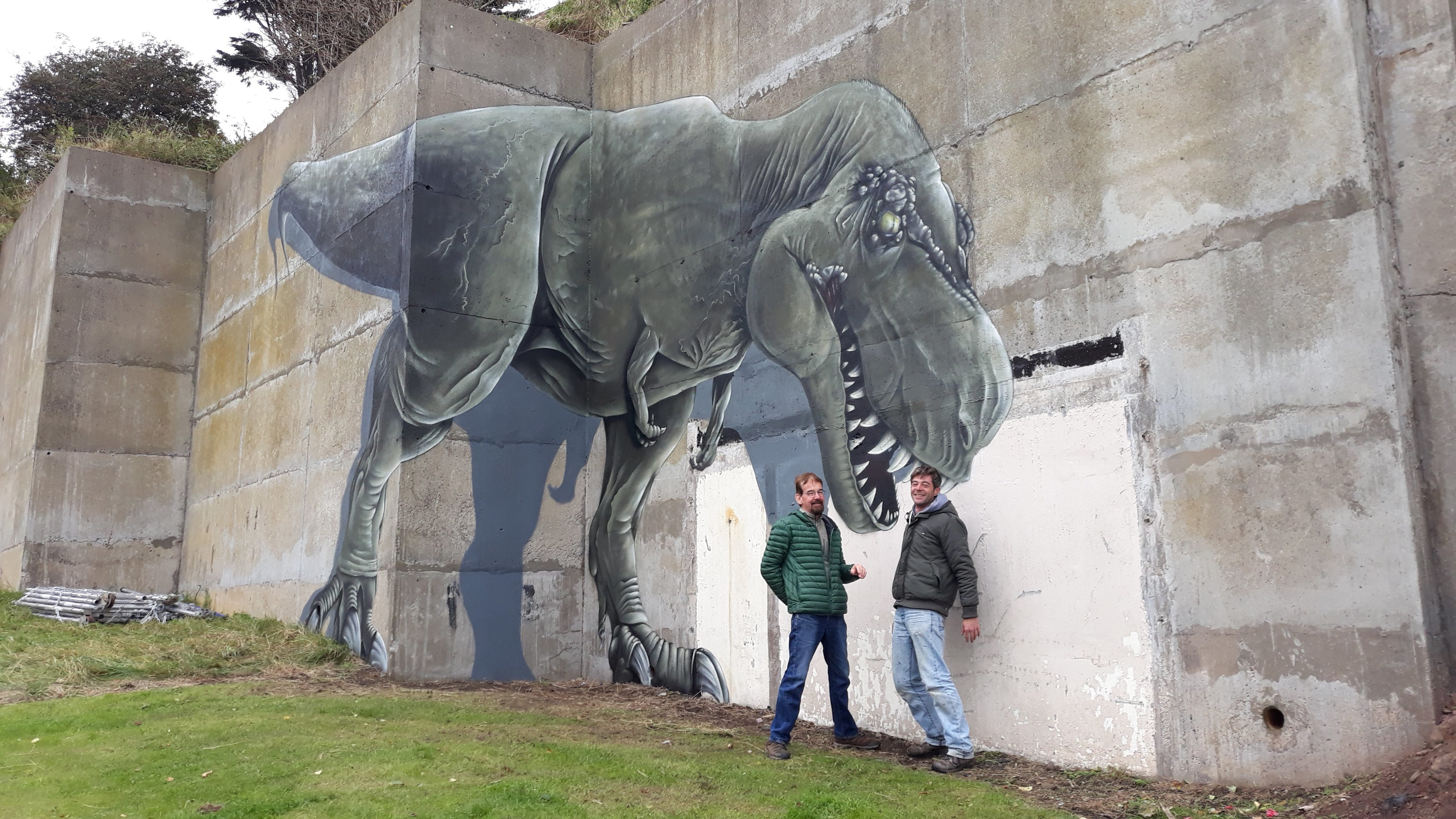 Bob Taylor, chairman of Community-Led Environmental Action for Regeneration, and artist Ian Tayak with the dinosaur art.