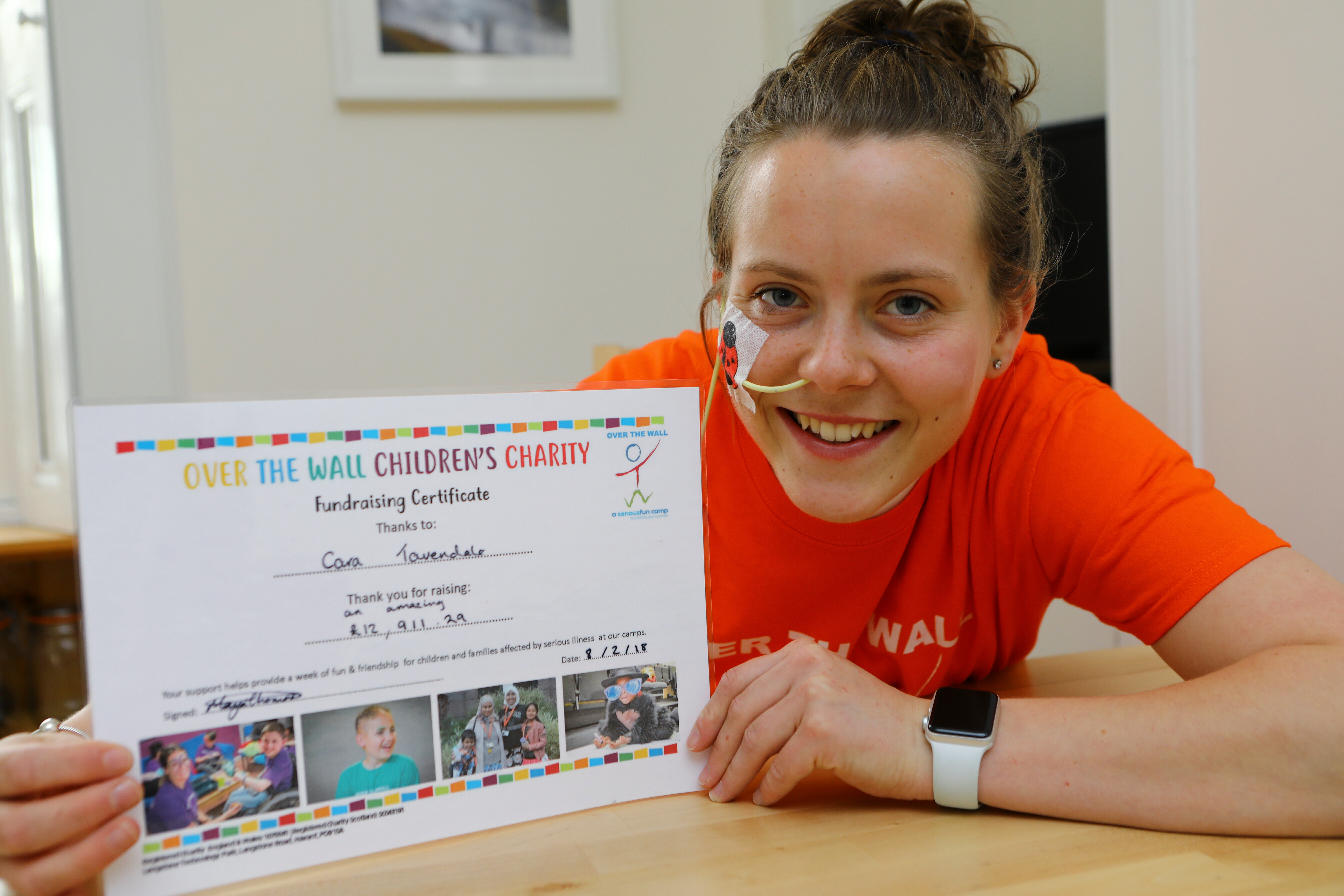 Cara Tavendale with the certificate from Over The Wall for raising over £12,000. Picture credit Dougie Nicolson.