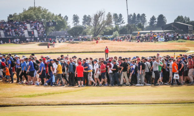 Large crowds lining the fairways to watch players including Tiger Woods. Pic shows large crowds following the big names round Carnoustie Golf Links and watching on the big screen. Saturday, 21st July, 2018.