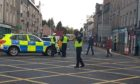 Police on the scene after the accident in the Bridgend Co-op.