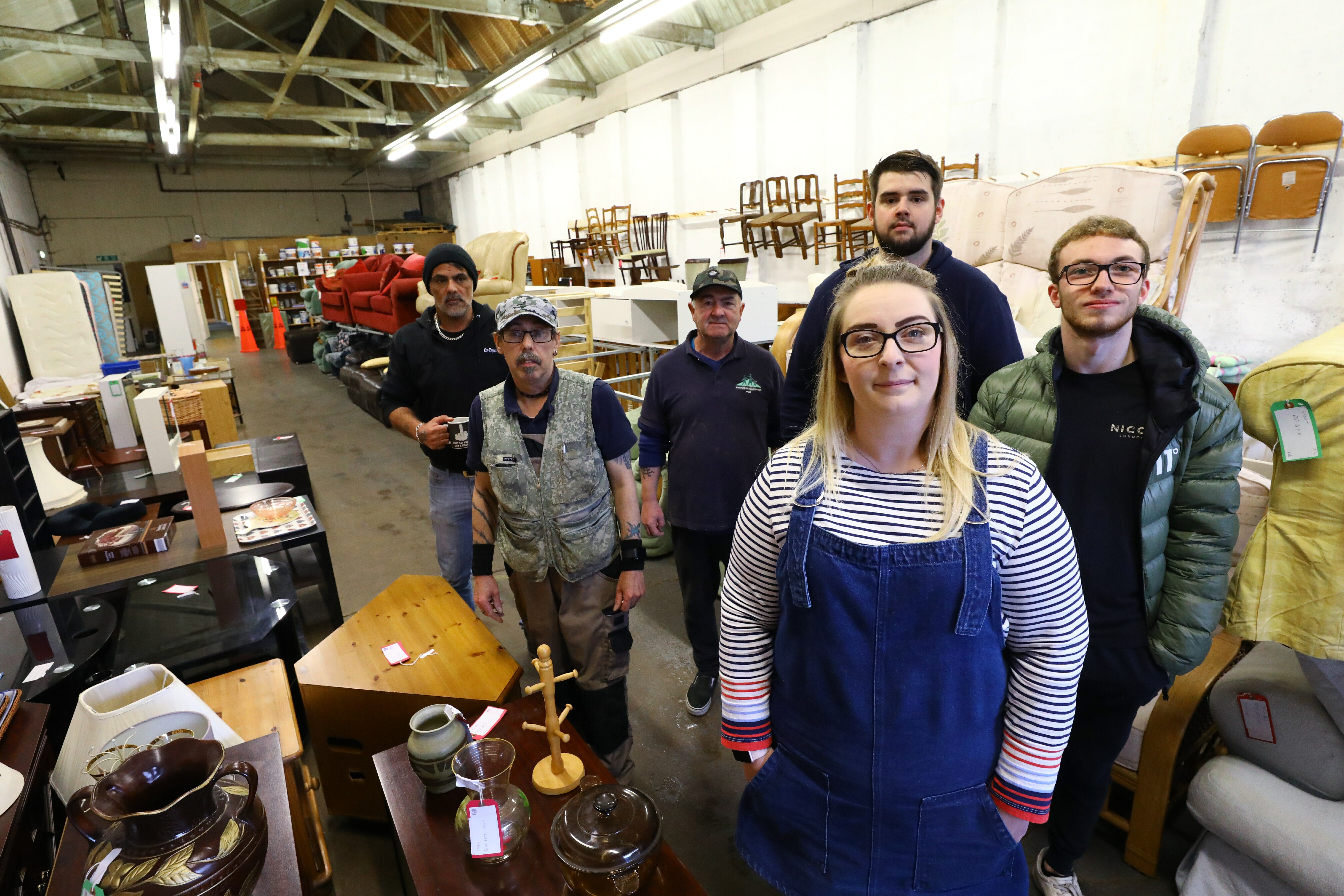 Elaine Duff, manager, at the Furniture Recycling Project Angus, in Arbroathwith volunteers Garry Brown, Martyn MacKinnon, John Mitchell, Ryan Bond and Craig Methven.