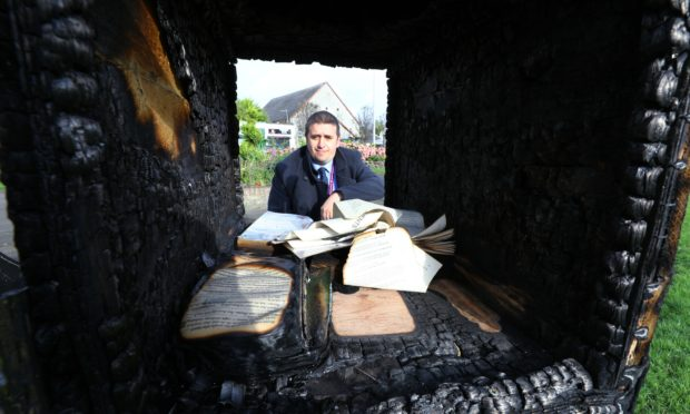David Graham beside the burnt out 'library' in College Street Gardens in Buckhaven.