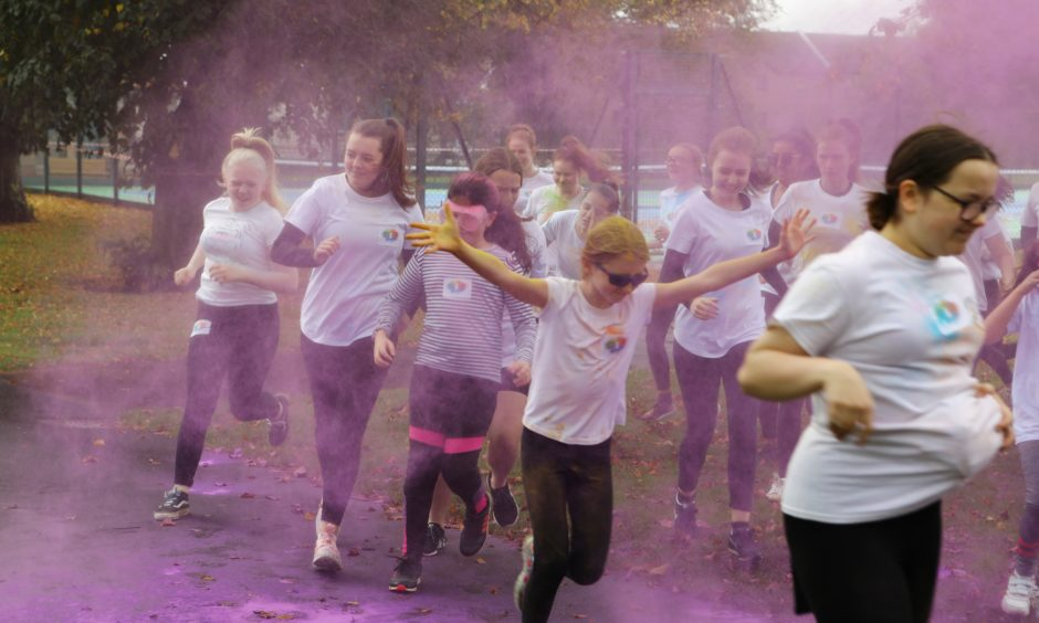 Runners go through one of the 'colouring stations' at the Colourama Run.
