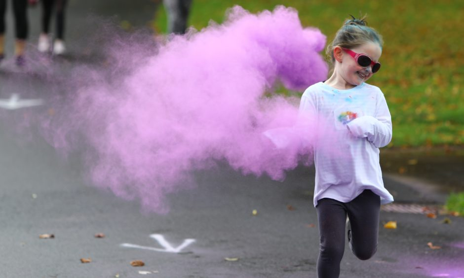 Runners embrace the colourama.