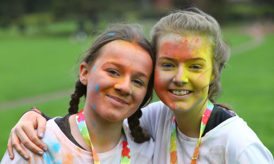 Millie Turnbull, left, age 14, and Lauren Carr, age 13, after finishing the Colourama Run.