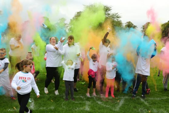 Coloured powder gets thrown at the start of one of the races, at the Colourama Run in Baxter Park, Dundee.