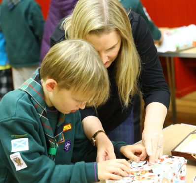 Cub scouts and their parents putting together the morale boxes. Picture: Dougie Nicolson.