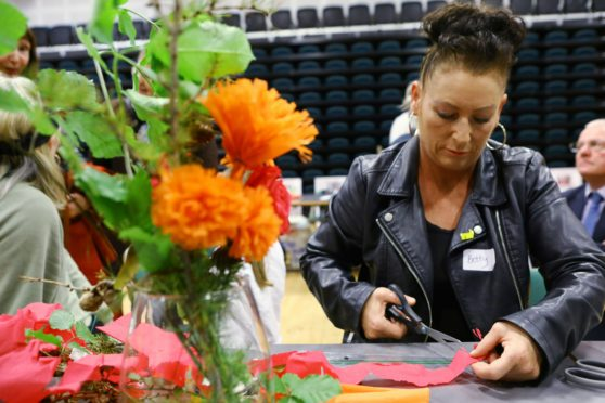 Betty McLaren making hand made flowers, at The Gathering.