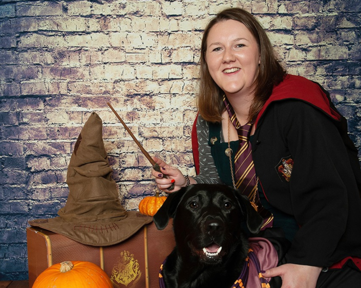 Emma Millar with her black Labrador Mickey. Picture courtesy of Downfield Studio Pet Photography.