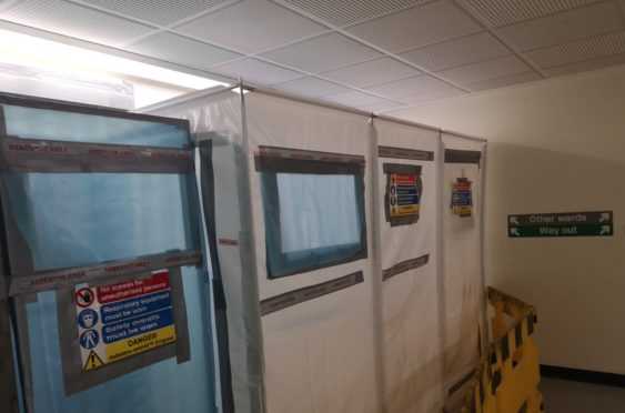 An asbestos warning in Ninewells Hospital.