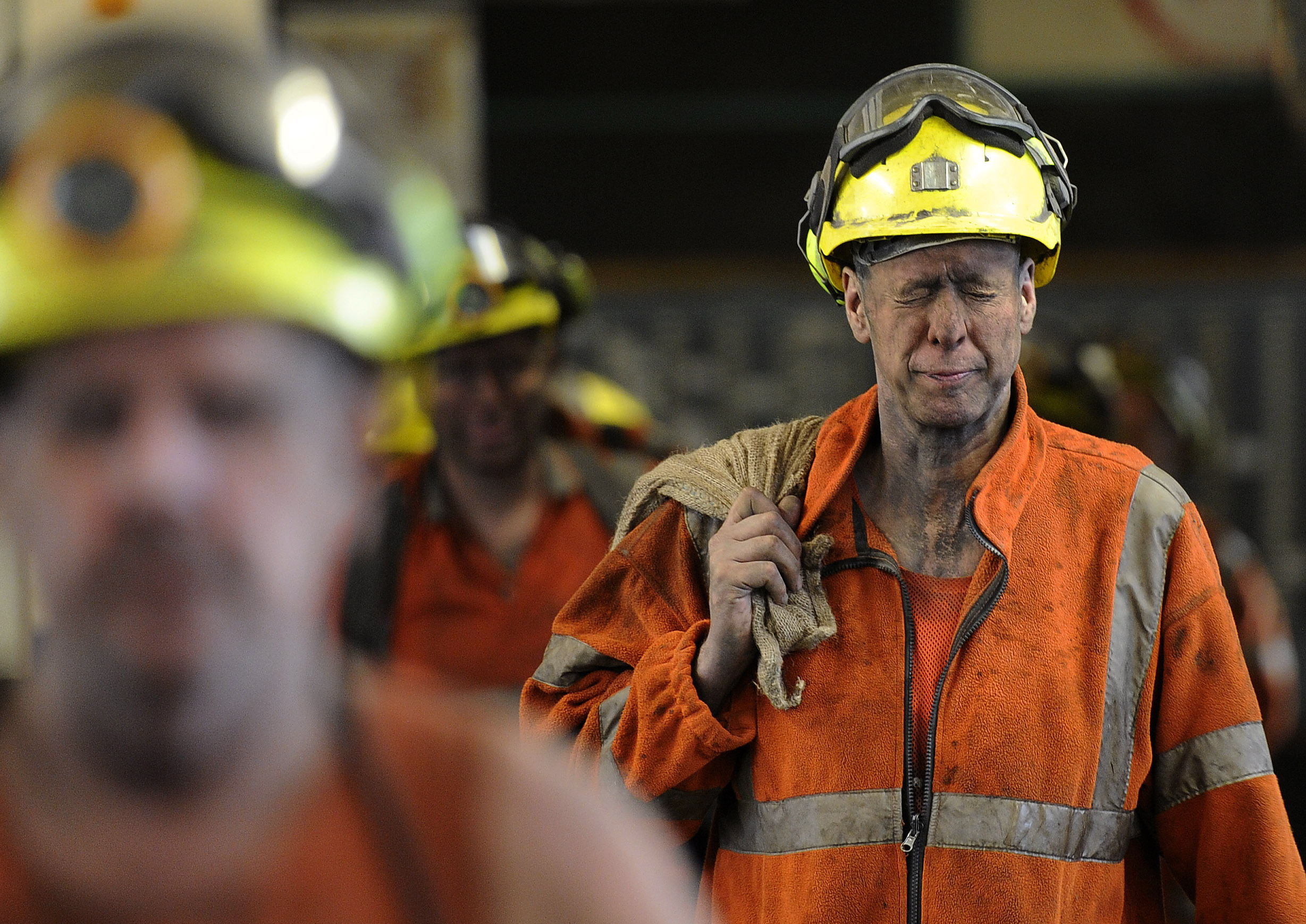 Miners come off the last shift.
