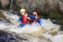 Gayle goes tubing on River Tummel.