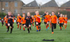 Dundee United players and the children enjoy a run together.