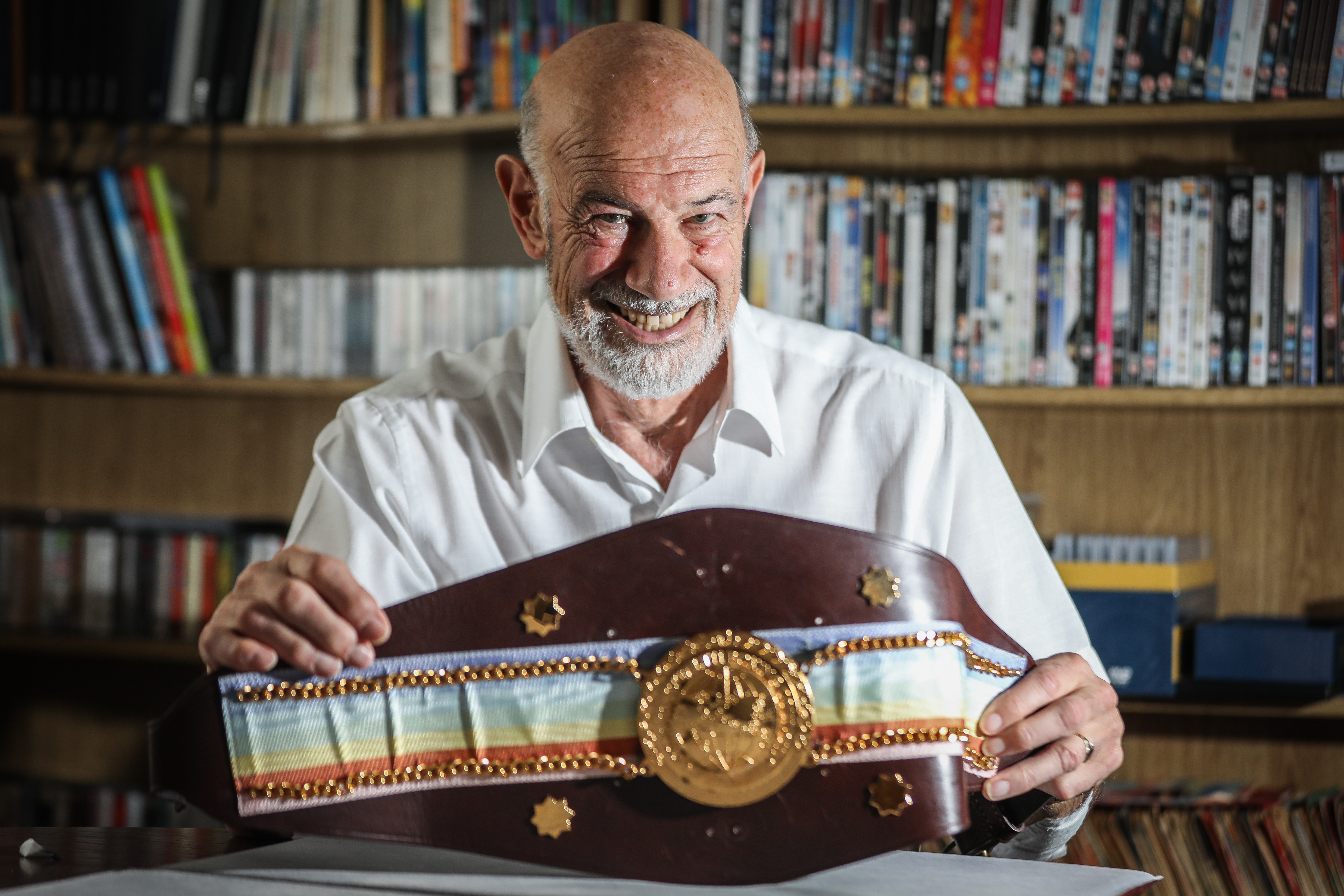 Angus aficionado Eric Armit with a prized Commonwealth Boxing Council title belt.
