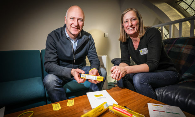 Joe Fitzpatrick MSP and Sarah Donaldson, Specialist Pharmacist discussing Naloxone