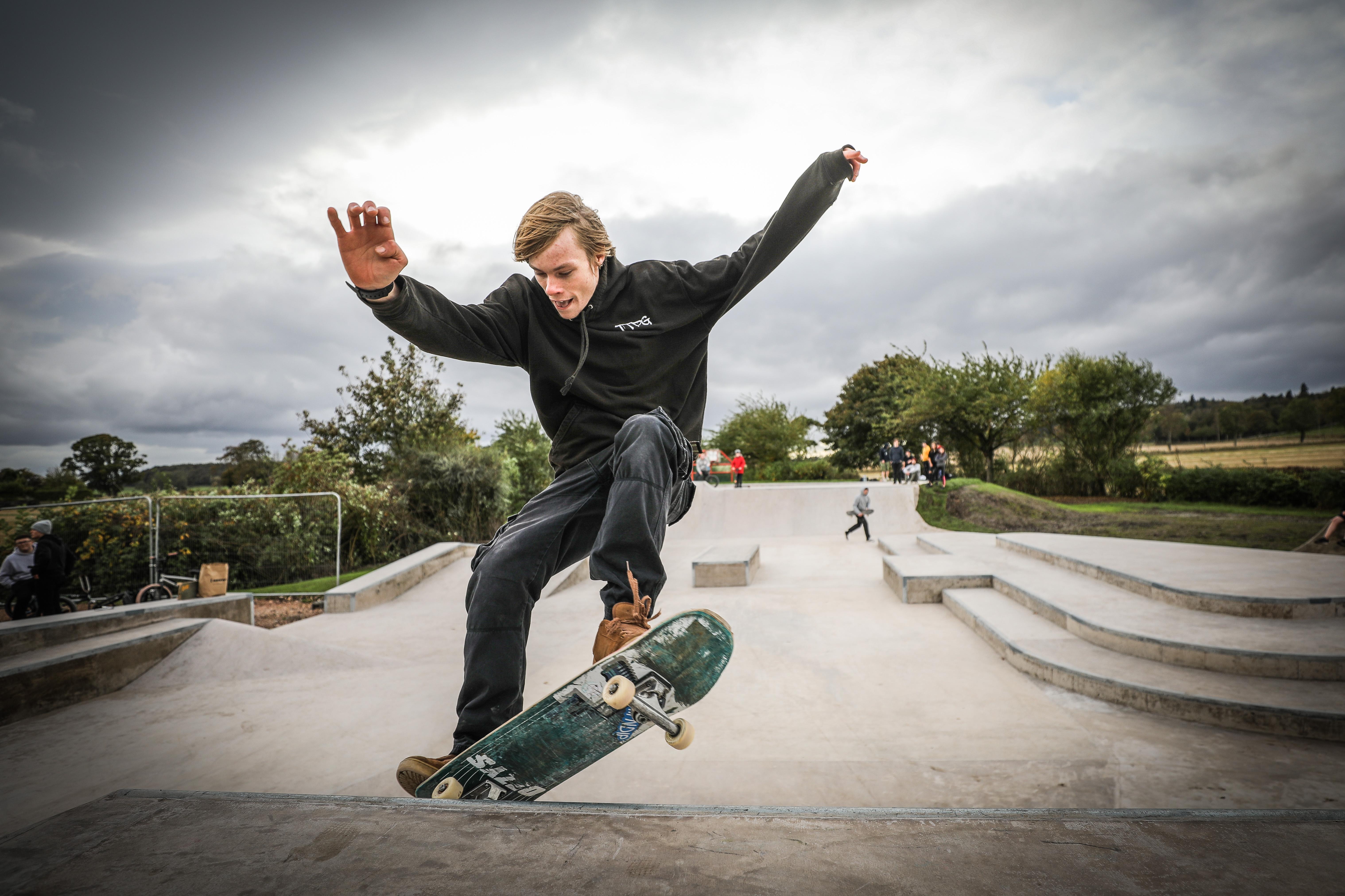 Adam Penman, Tayport Top Park Group chairman, tries out the new skatepark.