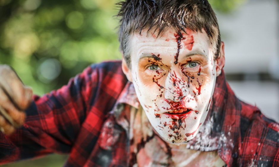 Theatrical make up and fake blood was used to give participants a ghoulish look to scare passers by.