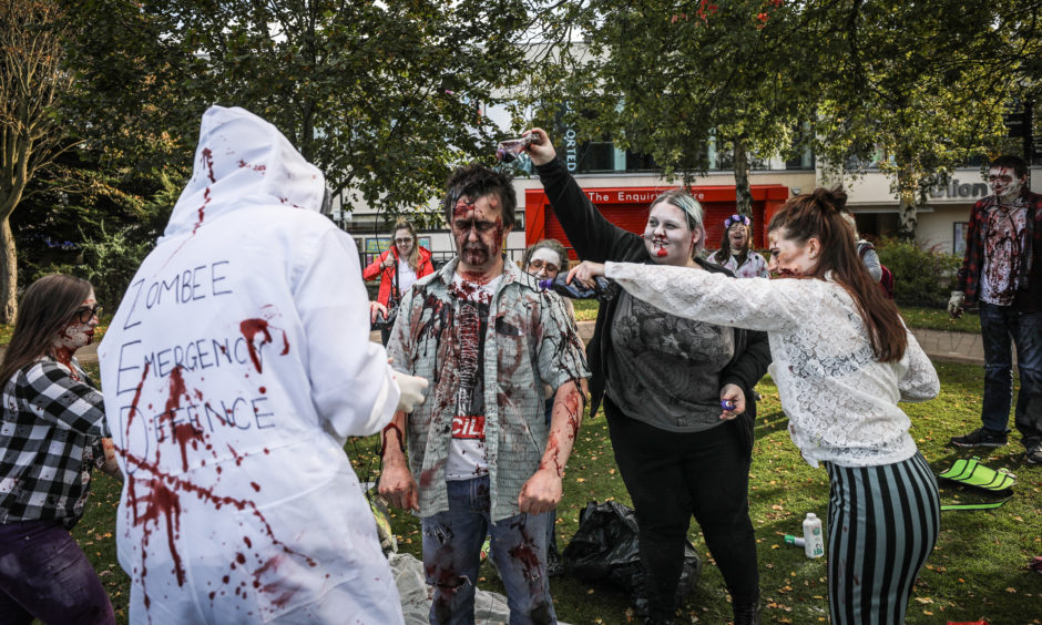Zombies prepare for the Dundee Zombie Walk.