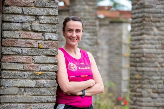 Police officer Kellyanne Muir is running two marathons to raise money to fund a day of research into brain tumours, having seen first hand the impact. Her mission has inspired fellow police officers and runners across Fife to take part in a virtual running challenge. CR0014912 Pic Kenny Smith, Kenny Smith Photography Tel 07809 450119