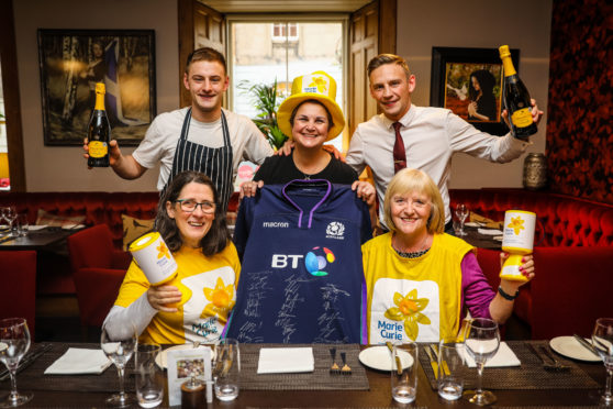 Picture Shows: (Back) Jamie Deans (Head Chef), Martine Sinclair (53), Lee Deans (Owner) and (Front) Alyson Johnston and Marion Thomson from Marie Curie. Picture credit Steve Brown.
