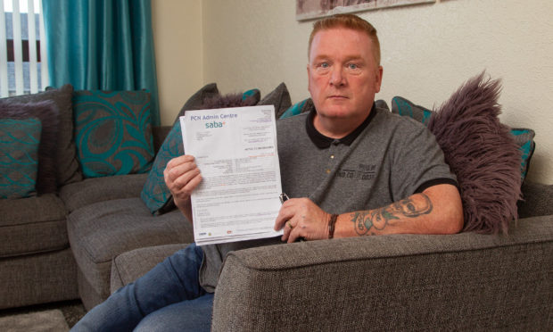Stephan Millar, who suffered heart attack and was taken to Ninewells Hospital, .got a parking ticket after his family car was parked at the hospital car park.