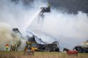 Firefighters fight a huge blaze at Netherton Equestrian Centre, Aberargie.