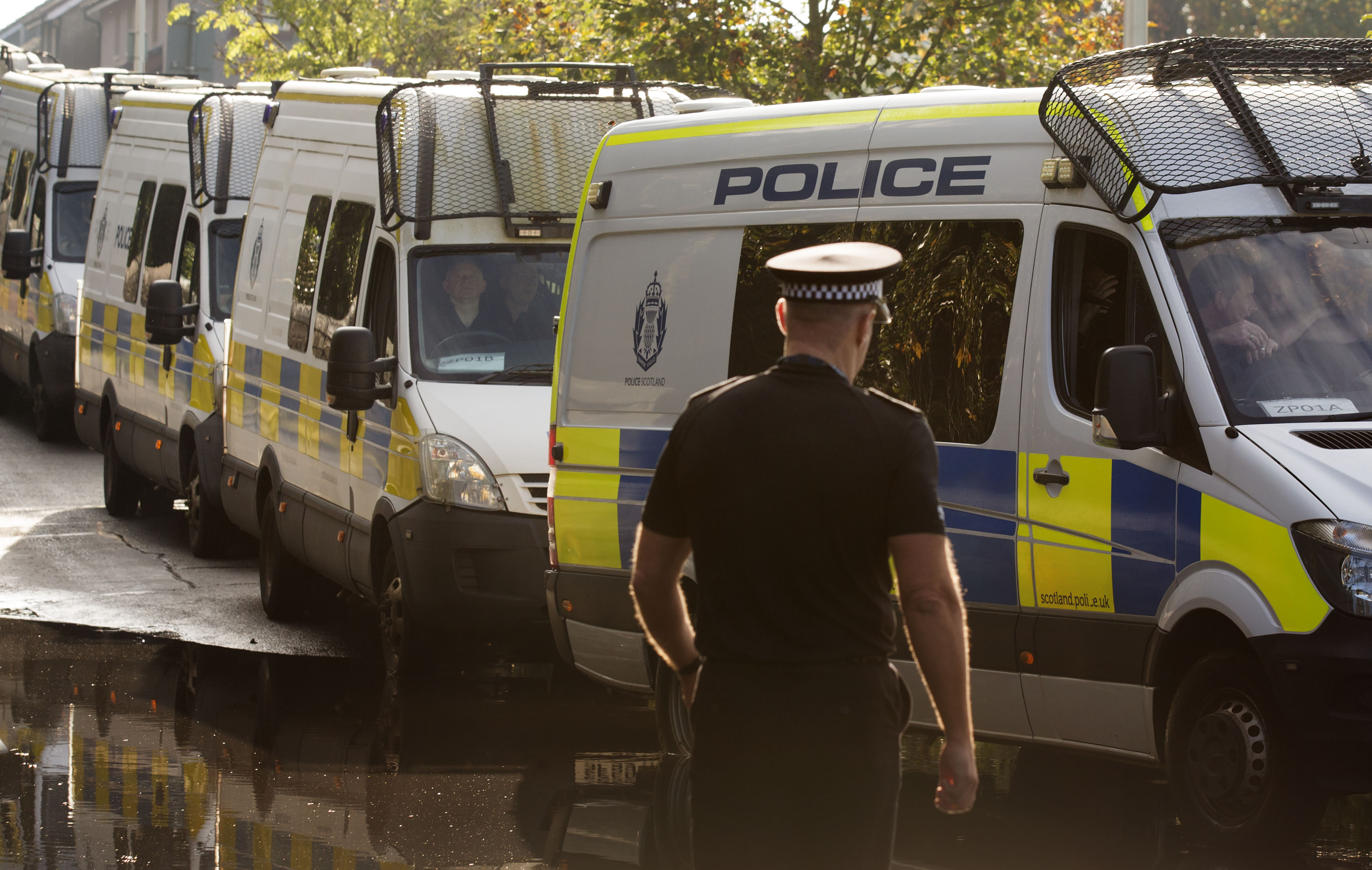 Vans leave from the Scottish Police College at Tulliallan Castle, Kincardine, carrying up to 100 police officers who are being deployed from Scotland to London to assist with policing of the Extinction rebellion climate change protests.