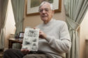 """Forfar historian Alex Whyte with one of his books on Forfar streets and places"""","""