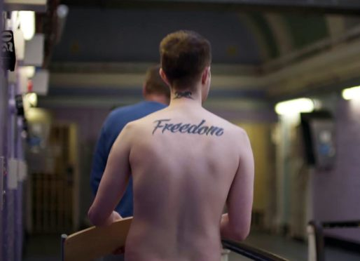 "Prisoner with ""Freedom"" tattoo."
