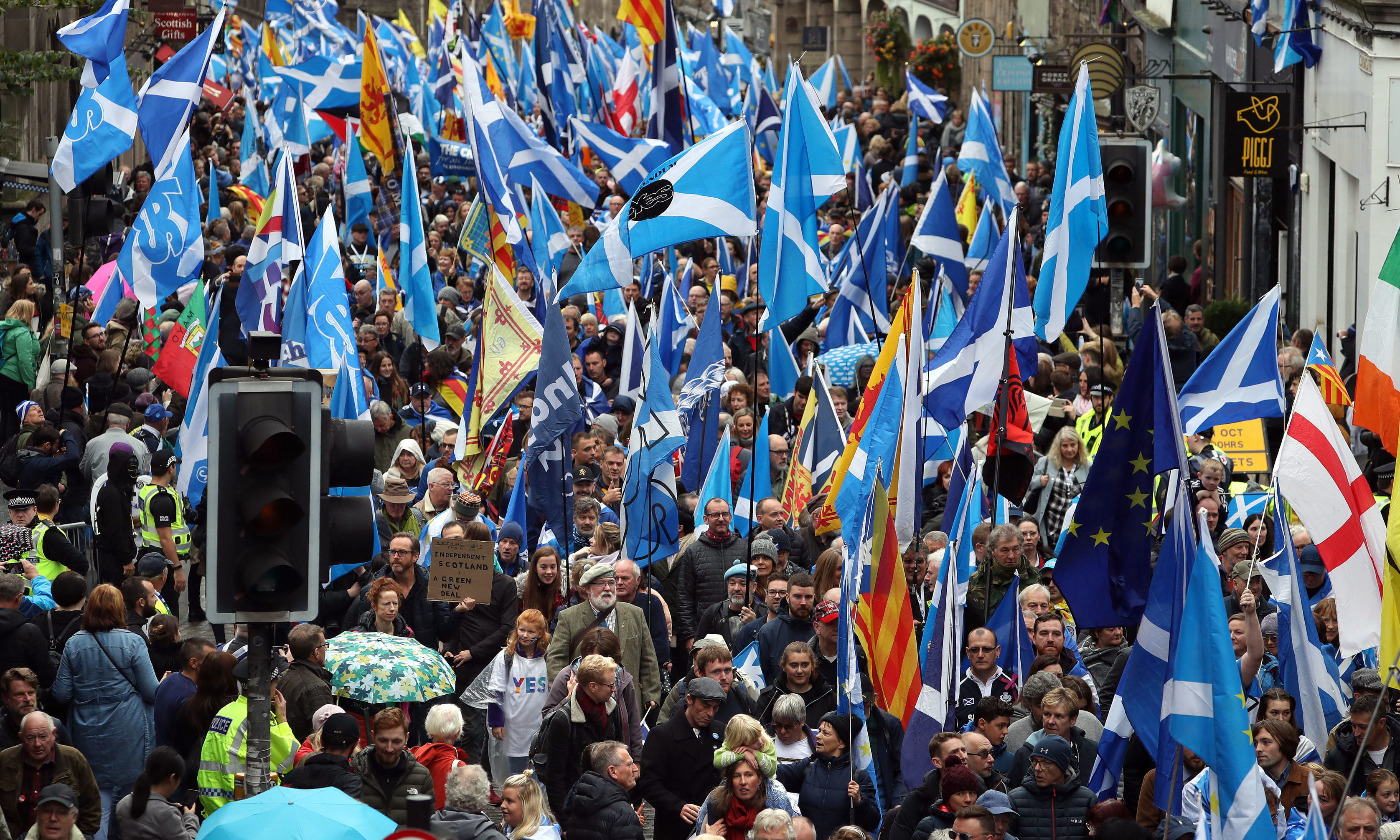 Scottish independence supporters march through Edinburgh during an All Under One Banner march. on Saturday, October 5.