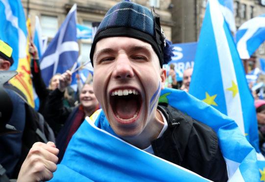 Scottish independence supporters march through Edinburgh.