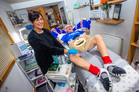 Joan will wax Ray Howe, aka Broxi Bear's, legs as part of the fundraiser