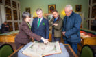 The Tay Cities Deal announcement. L-R: Lara Haggerty (keeper of the books at Innerpeffray Library) alongside MP Colin Clark, Luke Graham MP and local councillor Crawford Reid.