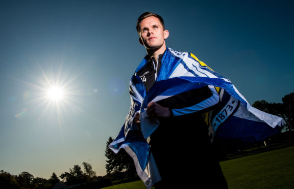 Lawrence Shankland shows his new Scotland colours.