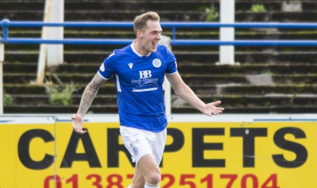 Kevin Holt celebrates making it 2-0 to Queens.