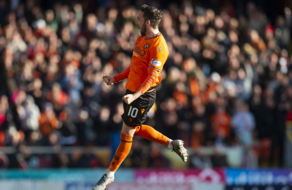 Nicky Clark jumps for joy after scoring his freekick.