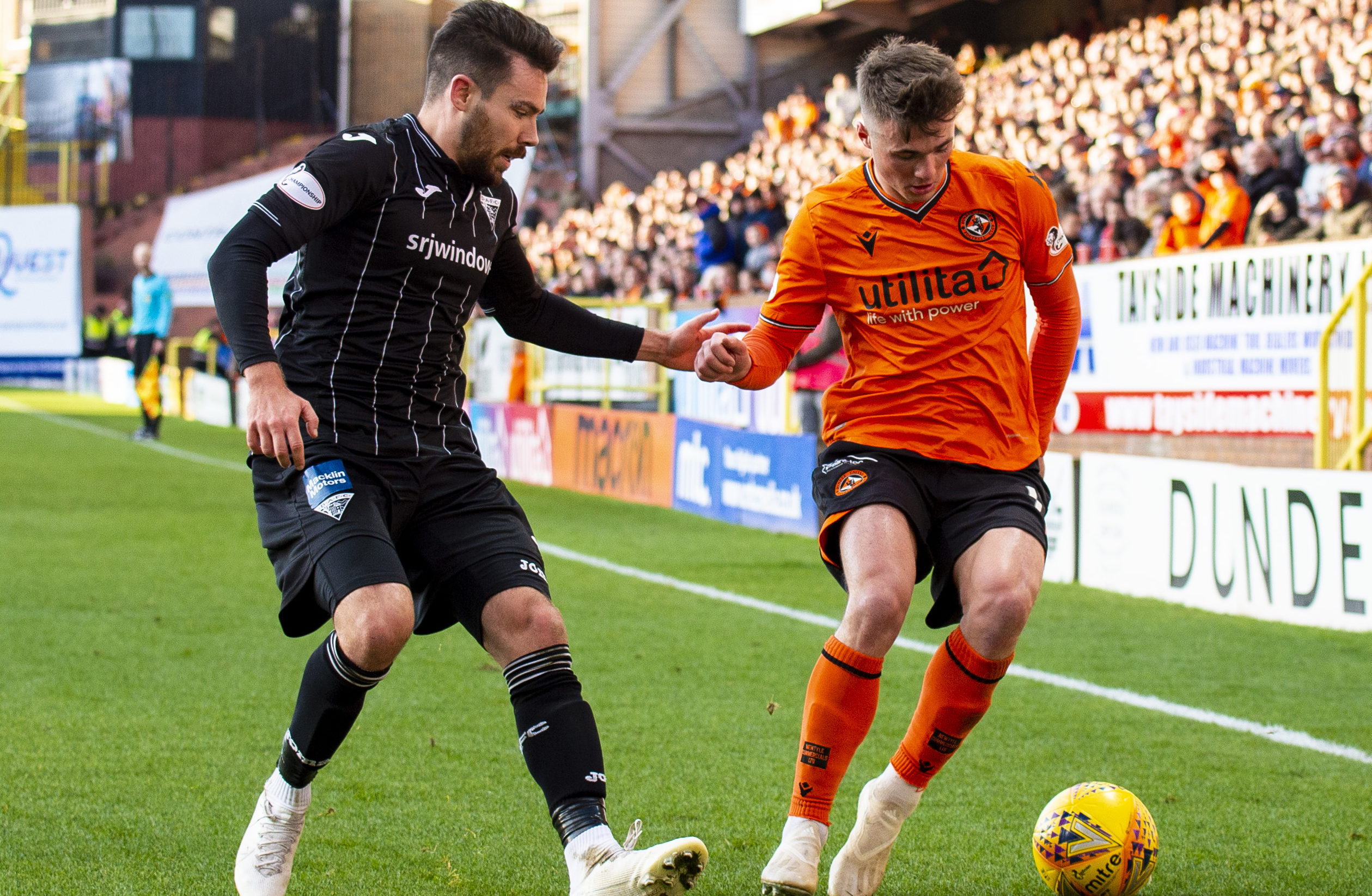Jamie Robson takes on Dunfermline player Ryan Dow.