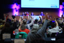 Delegates vote on motions at the STUC Conference. Picture: Phil Hannah.