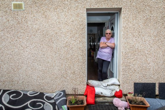 Annette Young at her home after the flooding in August.