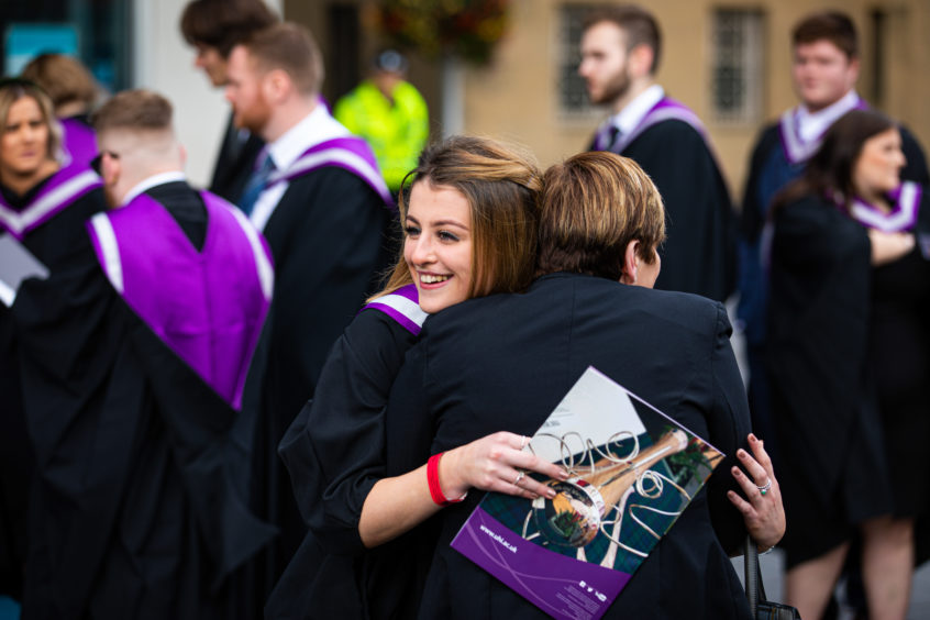 Courier News - Perth - Jamie Buchan - Perth University Graduation Day - CR0014814 - Perth - Picture Shows: Students waiting to be called for Graduation Ceremony at Perth Concert Hall, but there is always time for a cuddle - Thursday 3rd October 2019 - Steve Brown / DCT Media