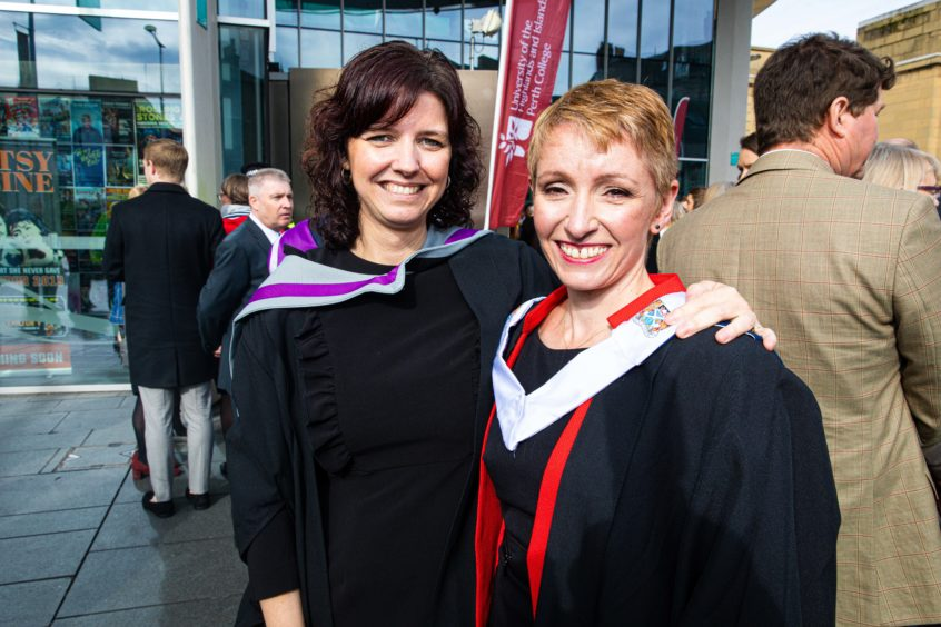 Lecturers Mura Camps and Kirsty Cassells, both from Perth, graduating today in postgraduate higher education.