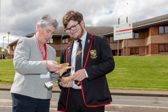Local councillor Mary Lockhart and pupil Bailey-Lee Robb (17) with one of the sub-standard sandwiches being served.