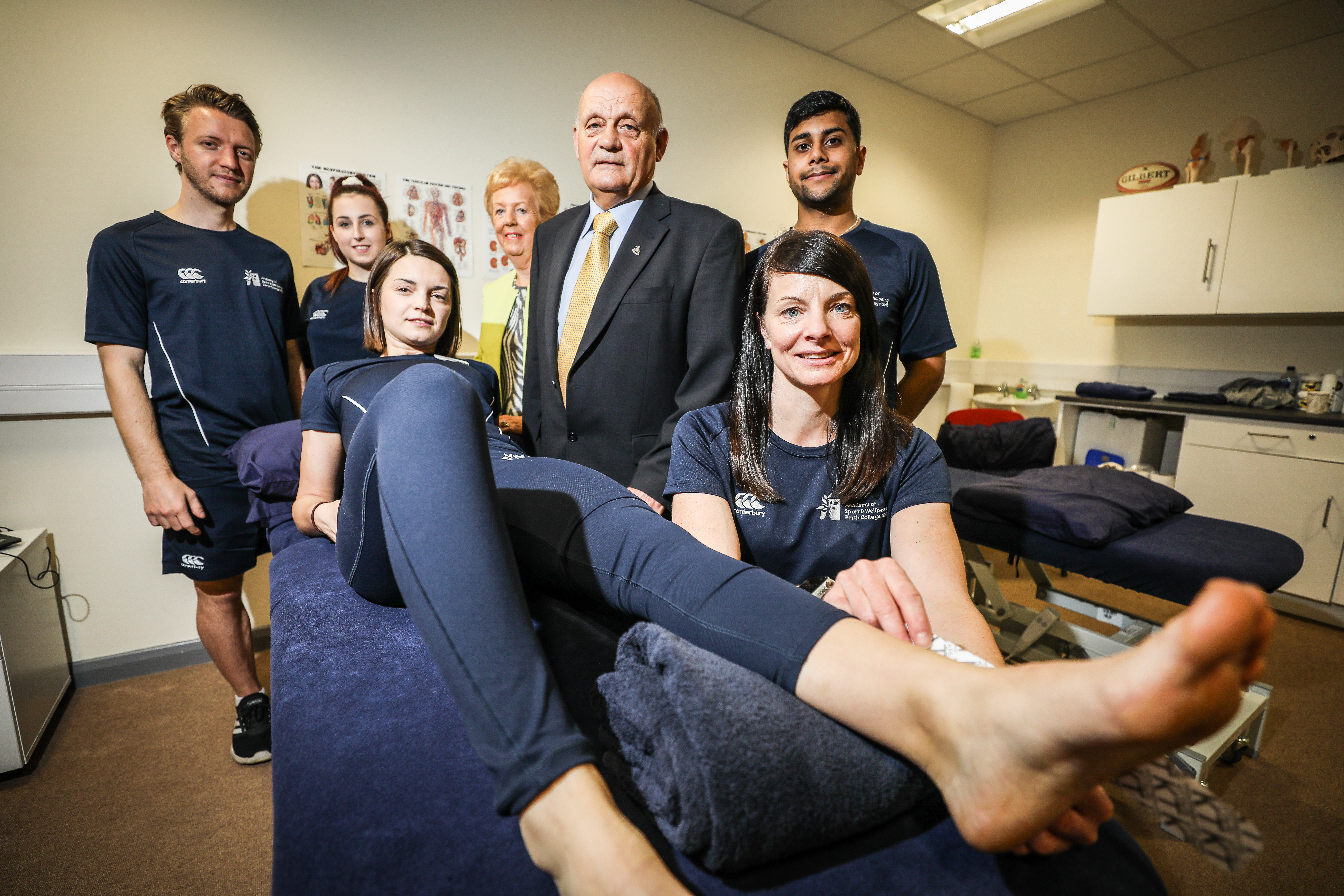 Students with Kenny  and Margaret Simpson at the opening of the sports injury clinic
