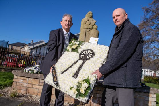 Rab McKenzie Chair of Valleyfield Heritage and Cllr Bobby Clelland, Retired Miners West Fife Branch lay a wreath following the ceremony in memory of those who lost their lives in the disaster