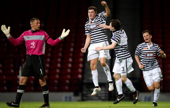 Sean Burns is congratulated by Andy Robertson and Lawrence Shankland after scoring for Queen's Park against Dundee.