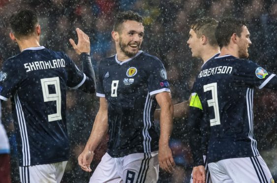 John McGinn's celebrates one of his goals.