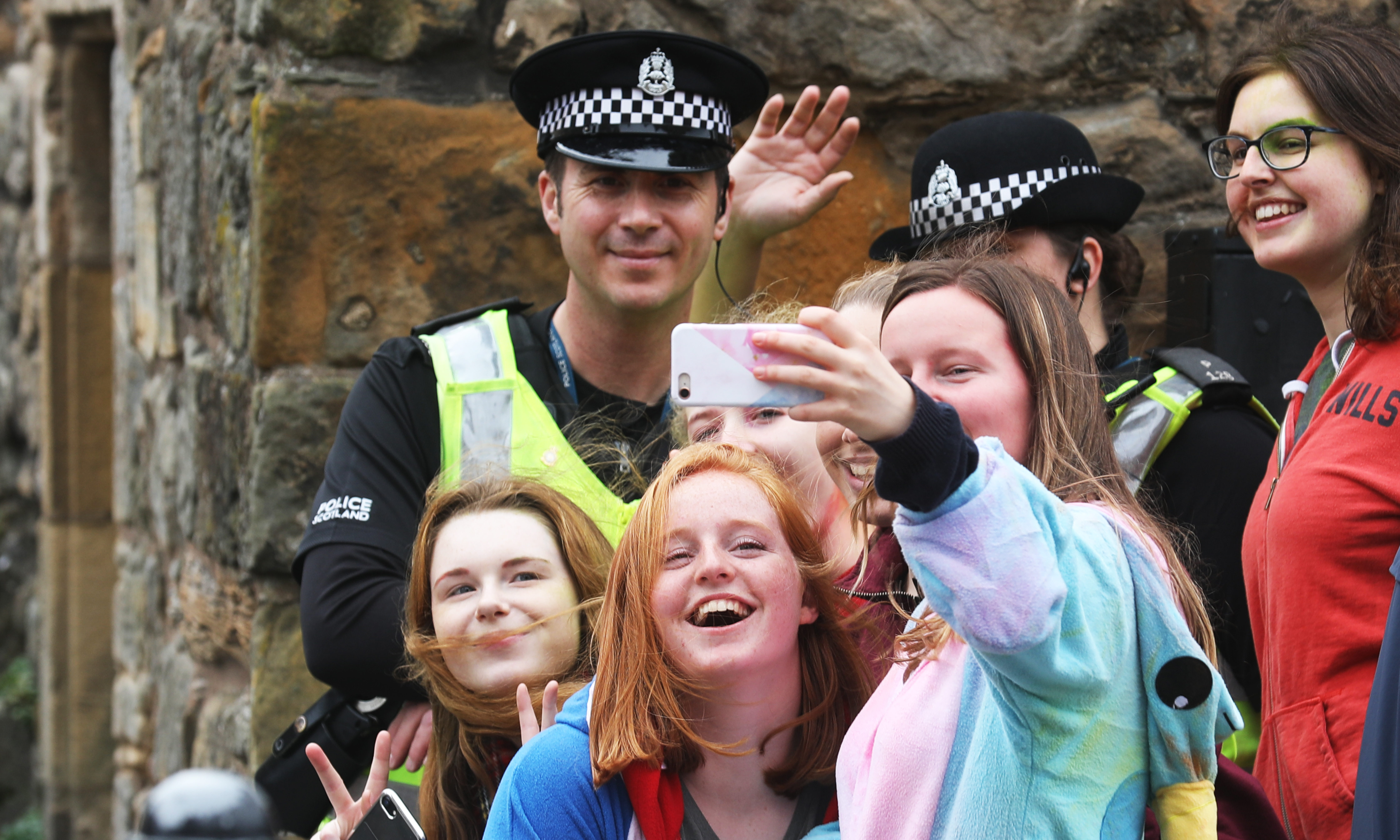 A group of students take a selfie with the police during Raisin Sunday last year.